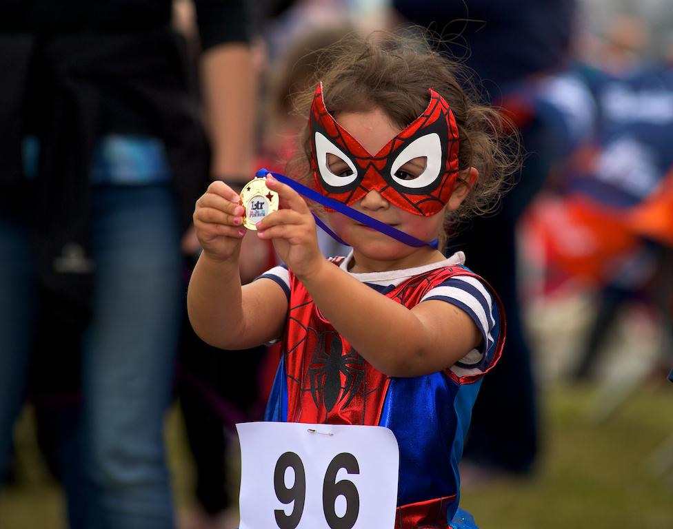 A proud medal winner at the BTR Kids Fun Run in 2015