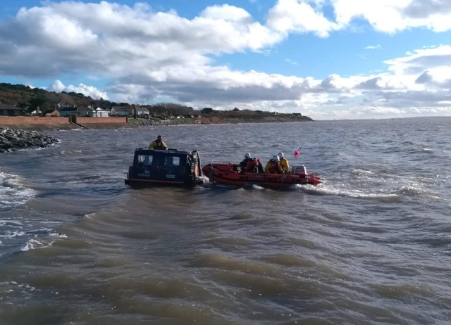 RNLI crew dash from wreath laying to carry out rescue