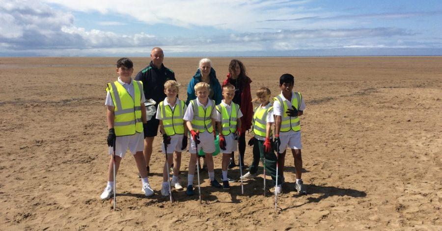 School pupils join beach litter clean-up