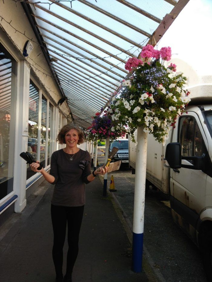 Members of West Kirby's small business owners' group tackle the weeding problem