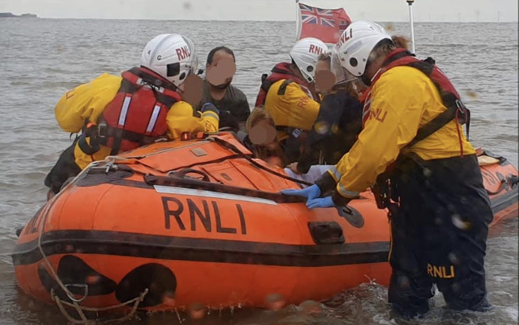 Lifeboat crews save group including young girl