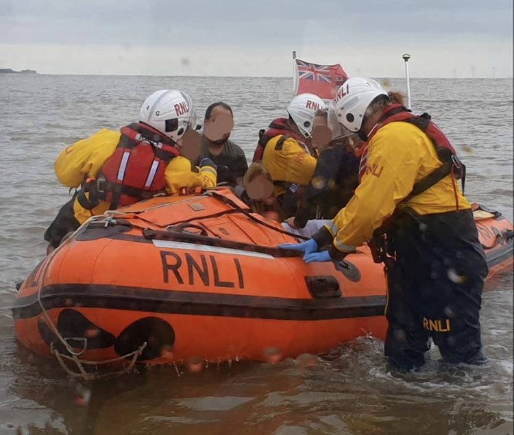 West Kirby lifeboat rescue Hilbre Island family cut off by tide.