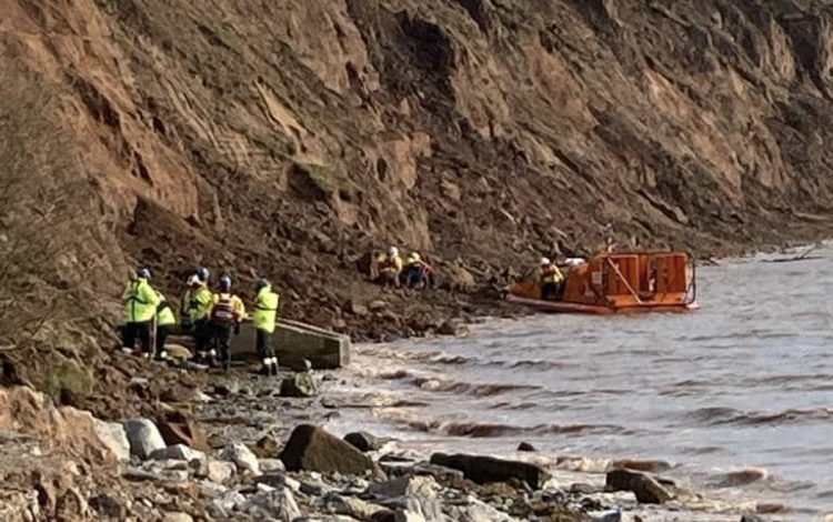 Two rescued from muddy debris caused by cliff collapse in Thurstaston