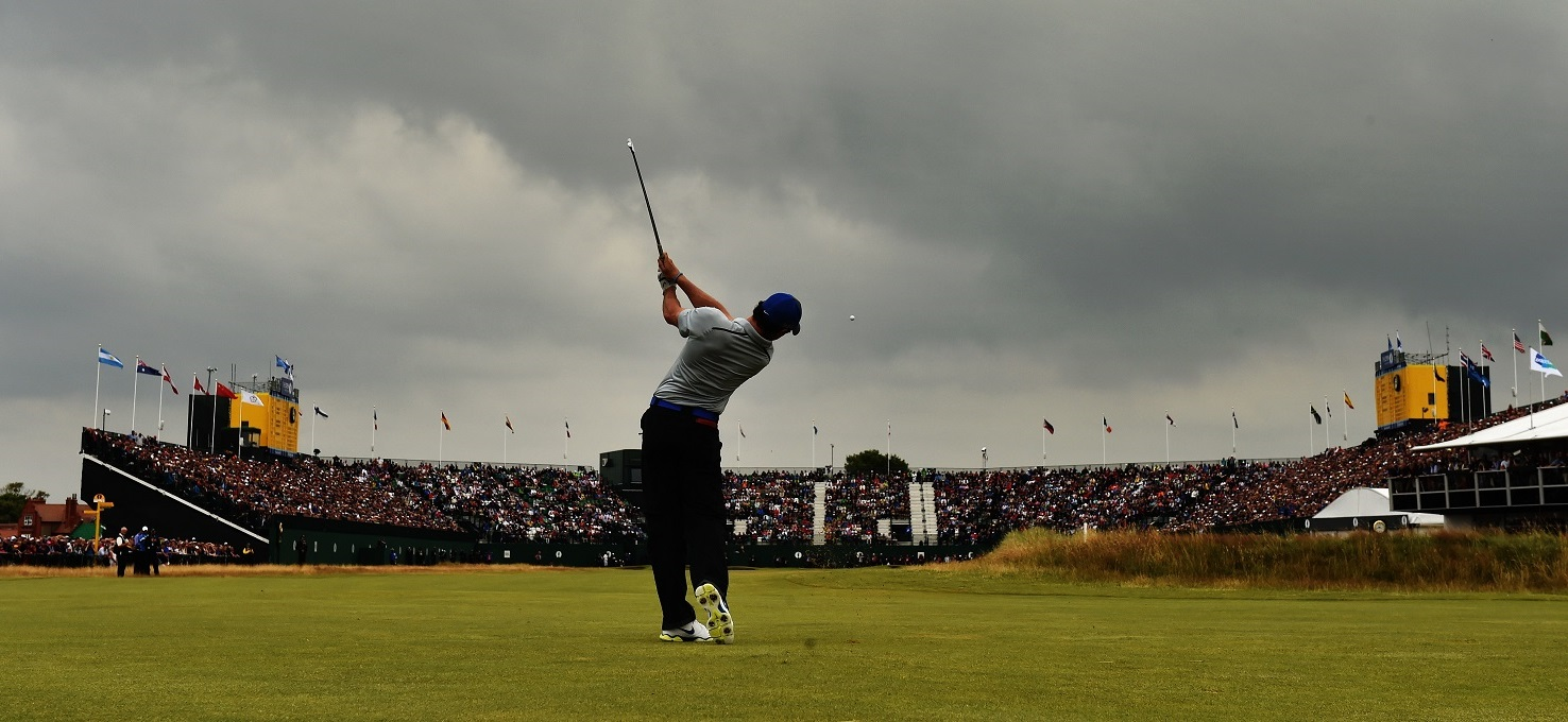 HOYLAKE, ENGLAND - JULY 19:  Rory McIlroy of Northern Ireland plays his second shot on the 18th hole during the third round of The 143rd Open Championship at Royal Liverpool on July 19, 2014 in Hoylake, England.  (Photo by David Cannon/R&A/R&A via Getty Images)