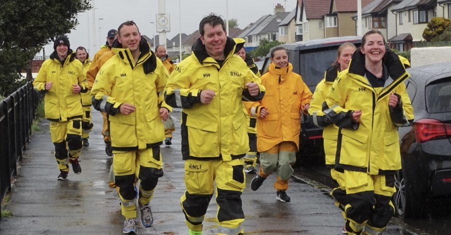 Hoylake RNLI volunteers raise thousands in rainy run
